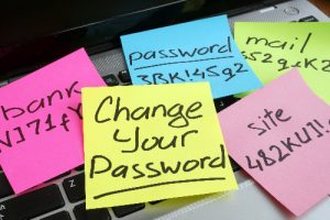 Scatterd Post-It notes with passwords written on them